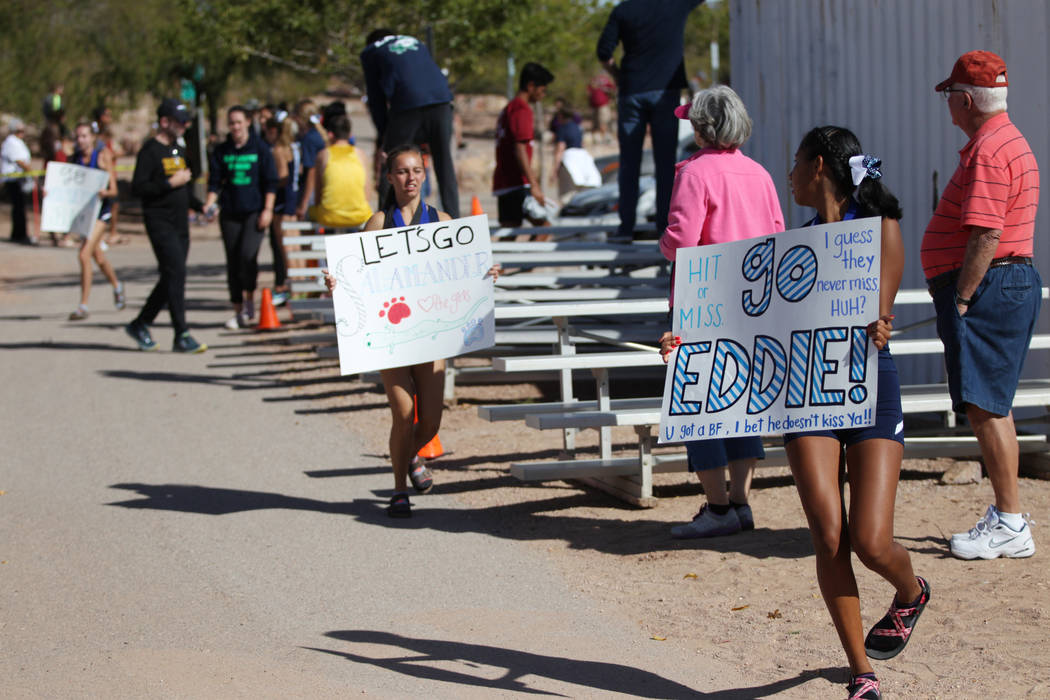 People show signs in support of runners competing in the NIAA 4A Boys Cross Country State Championship at the Veteran's Memorial Park in Boulder City, Saturday, Nov. 3, 2018. Erik Verduzco Las Veg ...