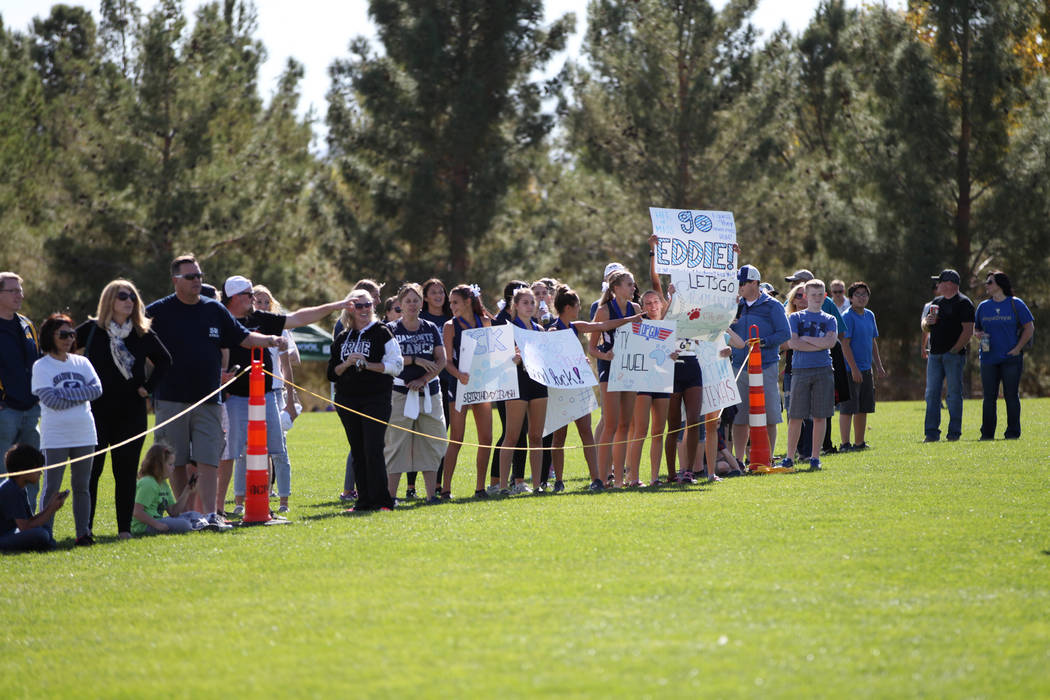 People cheer for runners getting ready to start in the NIAA 4A Boys Cross Country State Championship at the Veteran's Memorial Park in Boulder City, Saturday, Nov. 3, 2018. Erik Verduzco Las Vegas ...