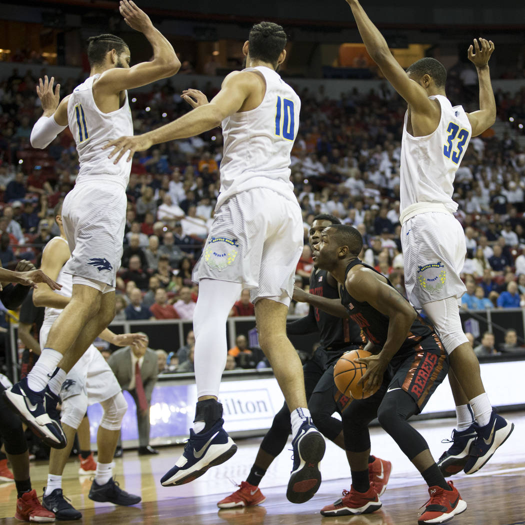 UNLV Rebels guard Jordan Johnson (24) catches Nevada Wolf Pack player on a pump fake in the second half of the Mountain West Conference men's basketball tournament game at the Thomas & Mack Ce ...