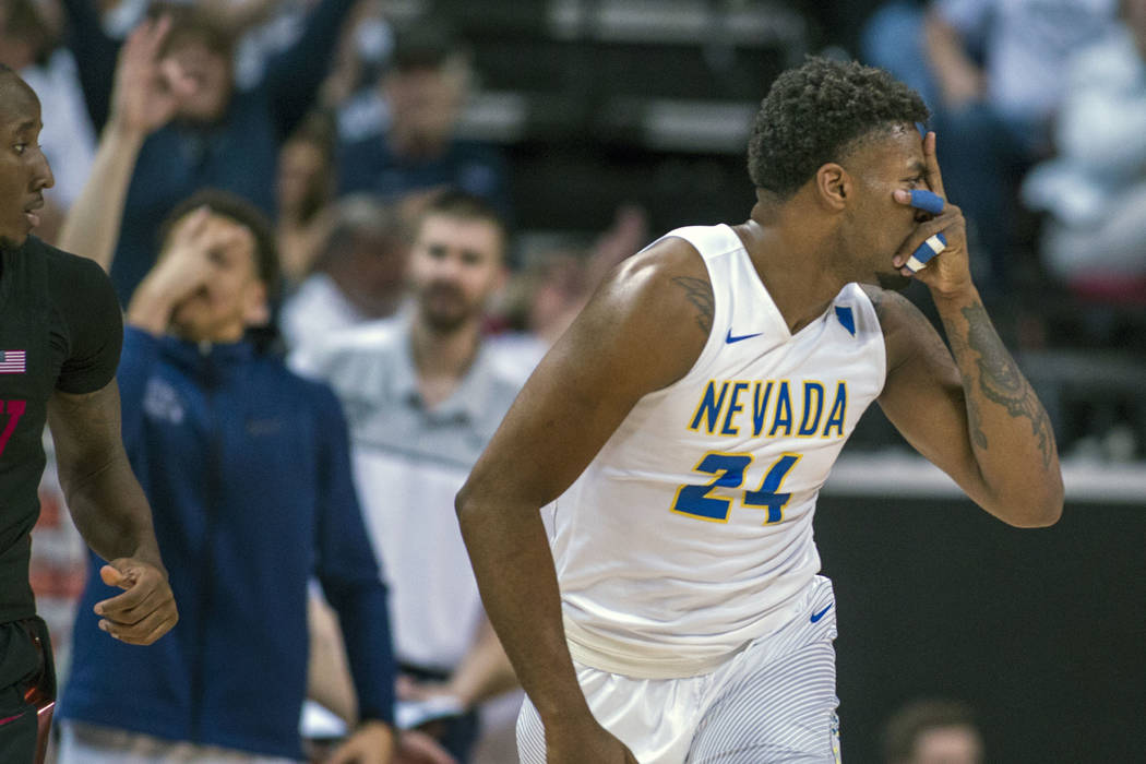Nevada guard Jordan Caroline (24) signals his teammates after another big shot over UNLV during the second half of an NCAA college basketball game in the quarterfinals of the Mountain West men's t ...