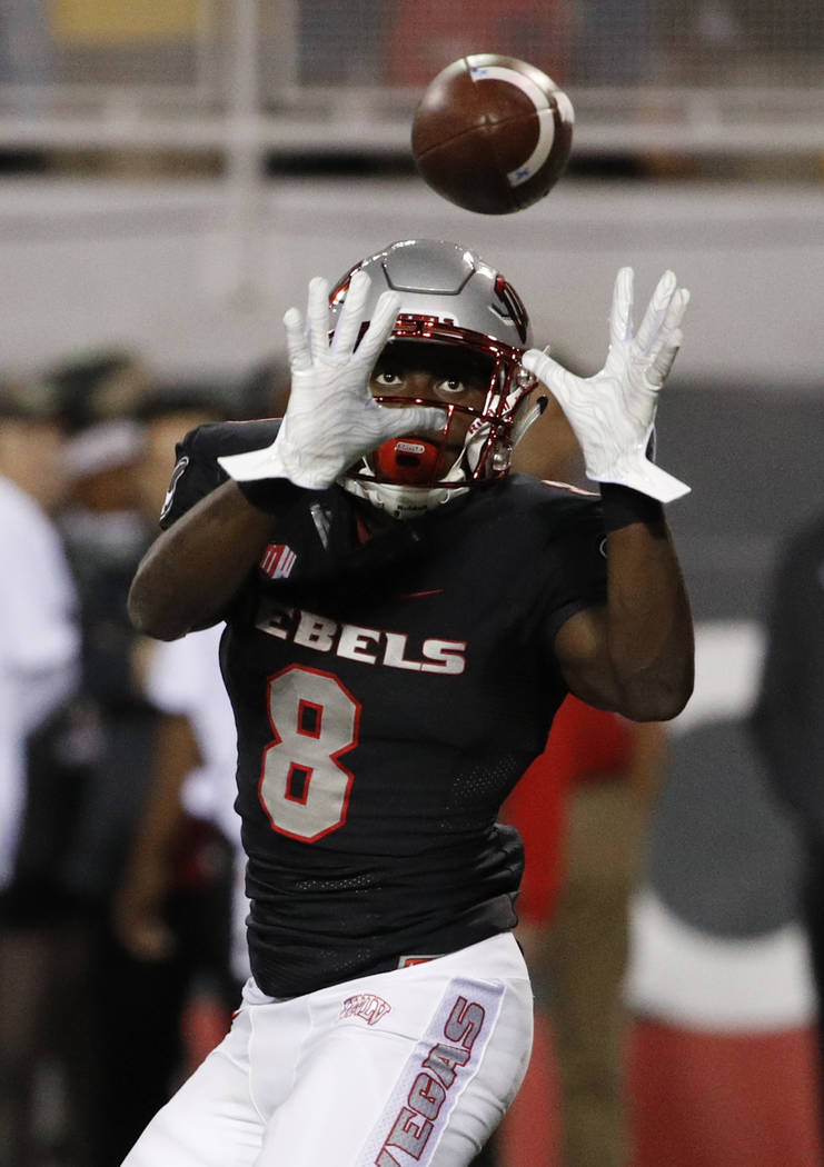 UNLV running back Charles Williams (8) makes a catch against the Fresno State Bulldogs during the second half of an NCAA college football game Saturday, Nov. 3, 2018, in Las Vegas. (AP Photo/John ...