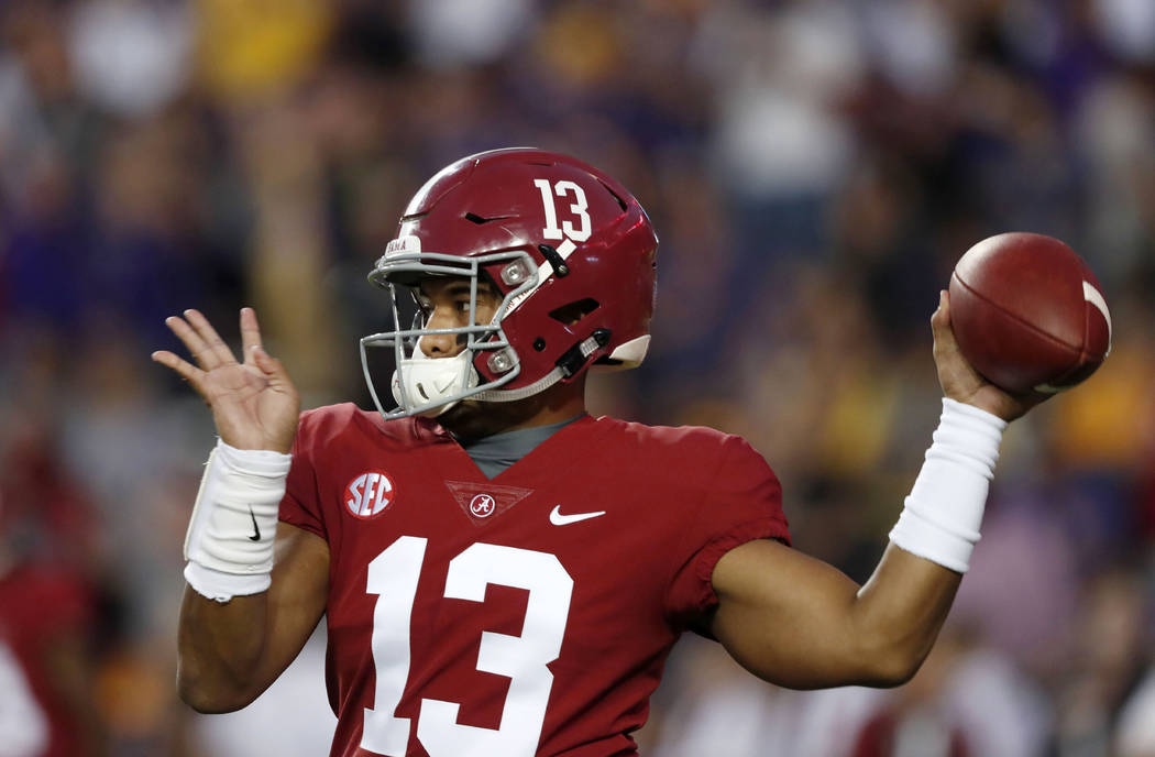 Alabama quarterback Tua Tagovailoa (13) warms up before an NCAA college football game against LSU in Baton Rouge, La., Saturday, Nov. 3, 2018. (AP Photo/Gerald Herbert)
