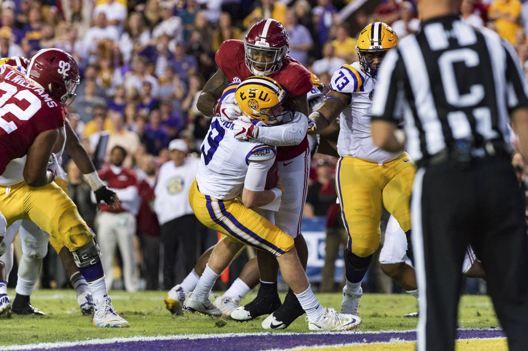 LSU quarterback Joe Burrow is sacked by Alabama linebacker Anfernee Jennings in an NCAA college football game in Lafayette, La., Saturday, Nov. 3, 2018. (Scott Clause/The Daily Advertiser via AP)