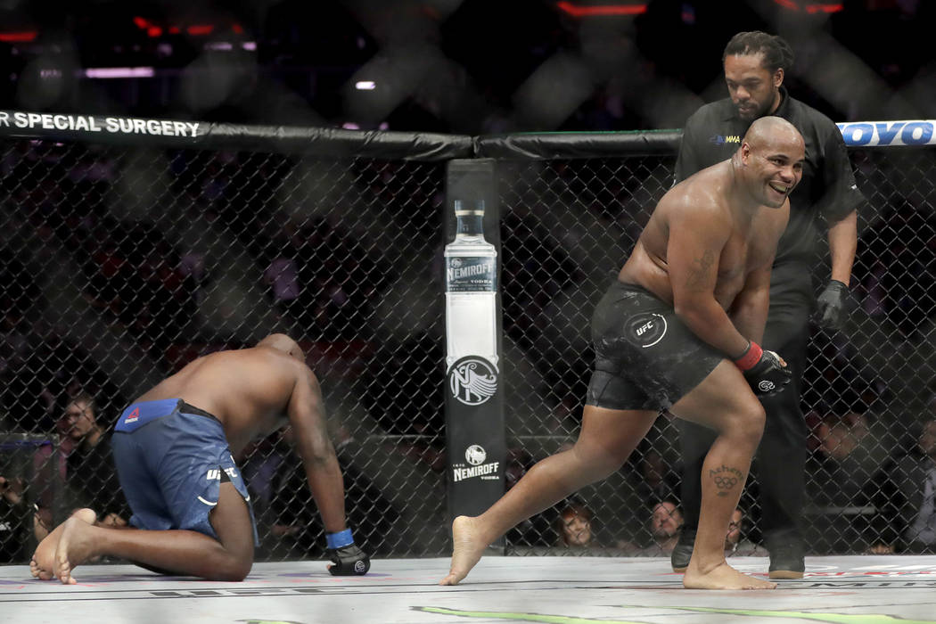 Daniel Cormier, right, reacts after defeating Derrick Lewis by submission during the second round of a heavyweight mixed martial arts bout at UFC 230, early Sunday, Nov. 4, 2018, at Madison Square ...