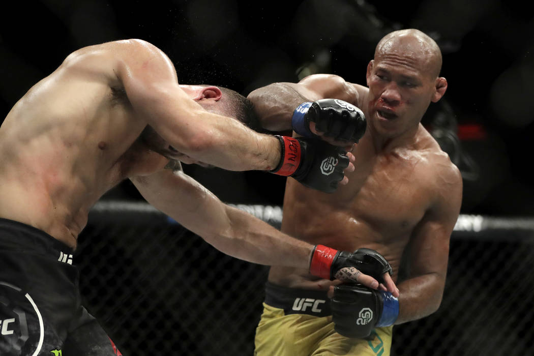 Ronaldo Souza, right, throws right at Chris Weidman during the third round of a middleweight mixed martial arts bout at UFC 230, Sunday, Nov. 4, 2018, at Madison Square Garden in New York. (AP Pho ...