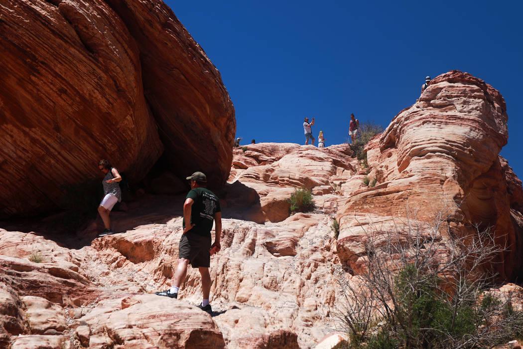 Visitors walk around Red Rock Canyon National Conservation Area in Las Vegas. (Andrea Cornejo/Las Vegas Review-Journal) @dreacornejo