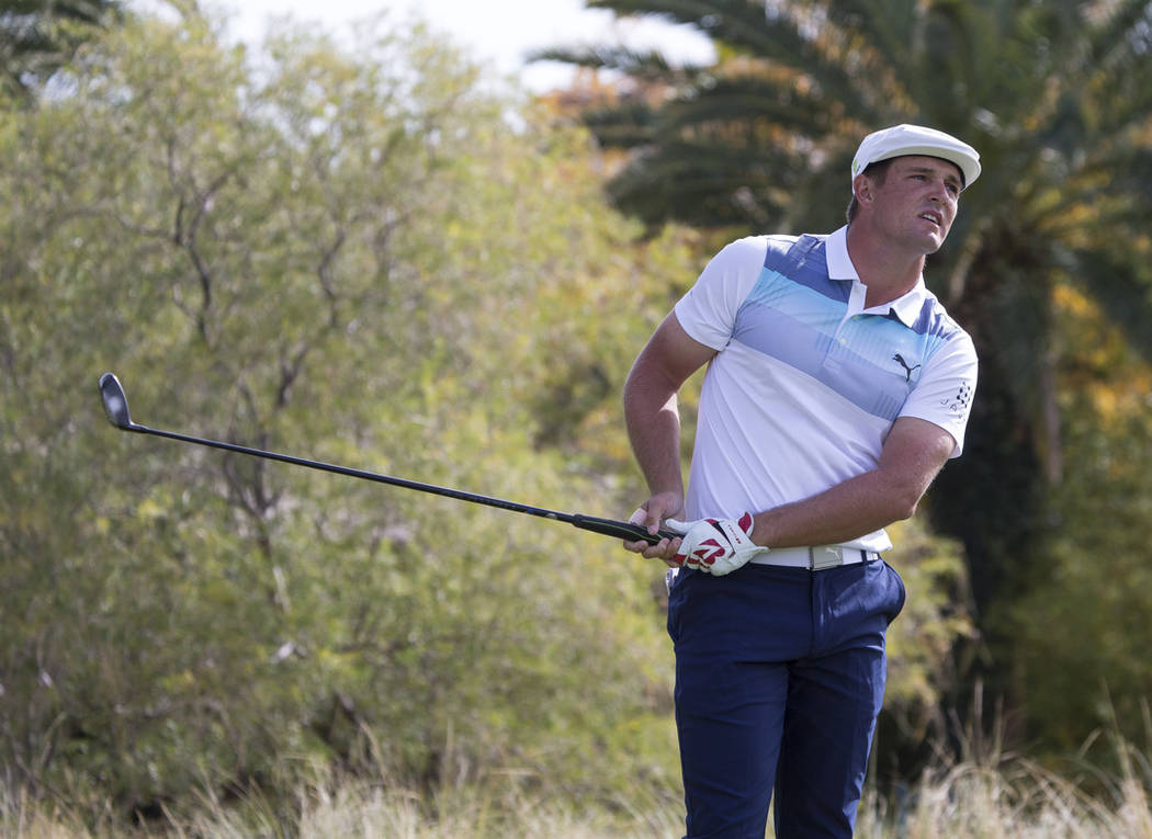 American golfer Bryson DeChambeau watches his shot after teeing off from the third box during the final round of the Shriners Hospitals for Children Open at TPC at Summerlin in Las Vegas on Sunday ...