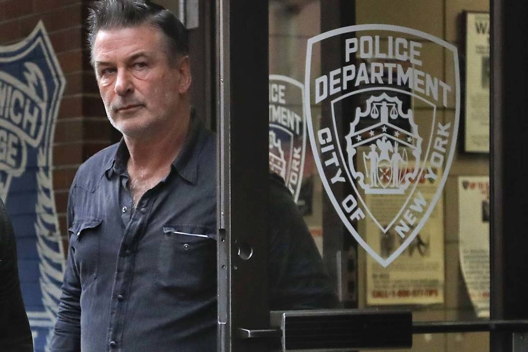 Actor Alec Baldwin walks out of the New York Police Department's 10th Precinct, Friday, Nov. 2, 2018, in New York. Baldwin was arrested Friday after allegedly punching a man in the face during a d ...