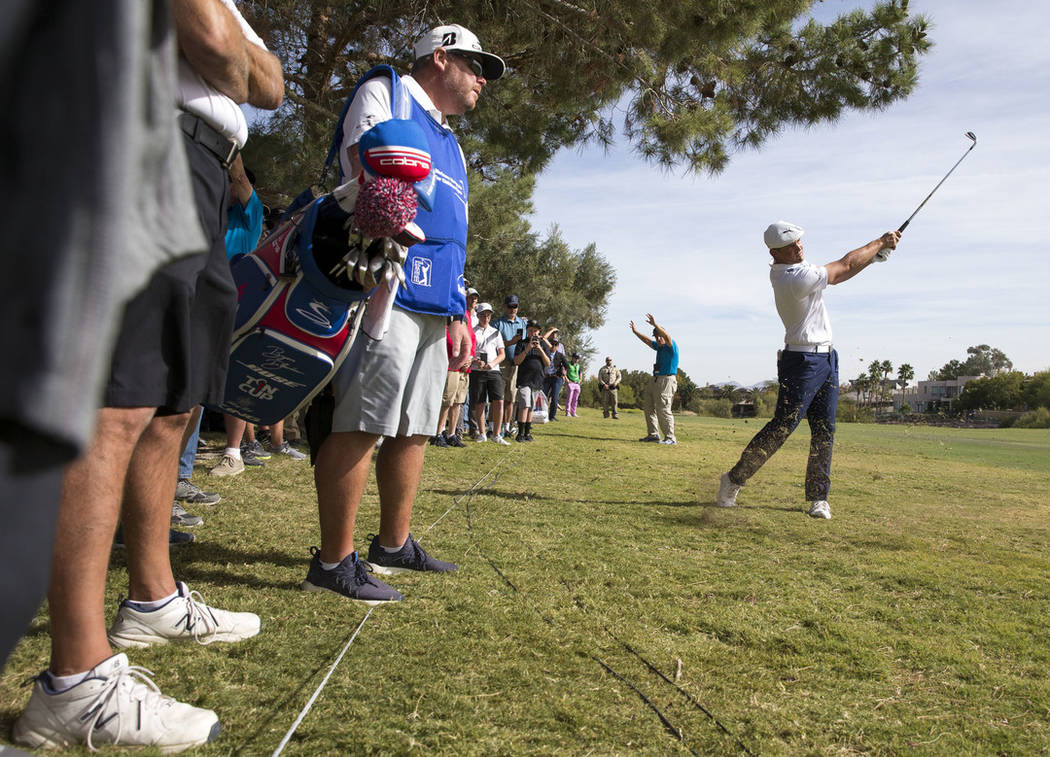 American golfer Bryson DeChambeau hits from the fairway on the third hole during the final round of the Shriners Hospitals for Children Open at TPC at Summerlin in Las Vegas on Sunday, Nov. 4, 201 ...