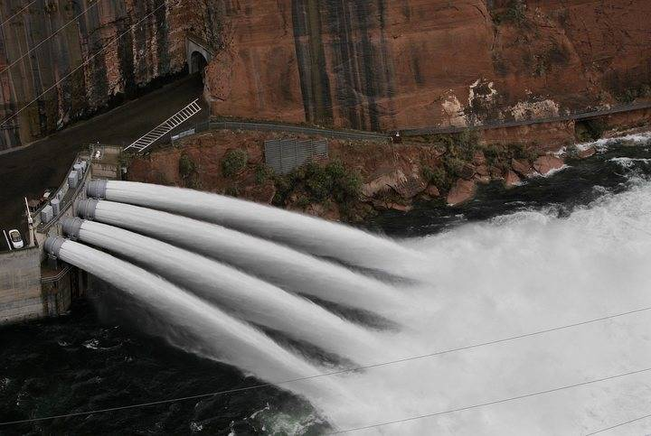Water is released from Glen Canyon Dam near Page, Arizona on Sunday, Nov. 21, 2004. (AP Photo/Laura Rauch)