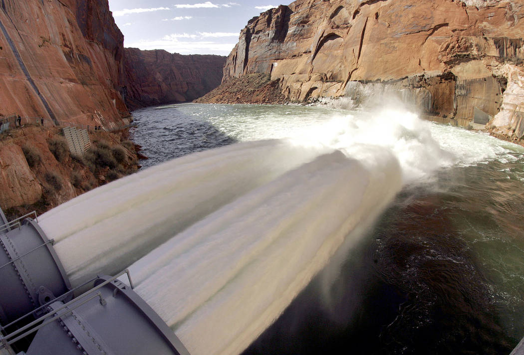 Water flows from the number one and two jet tubes at the Glen Canyon Dam Wednesday, March 5, 2008 in Page, Ariz. (AP Photo/Matt York)
