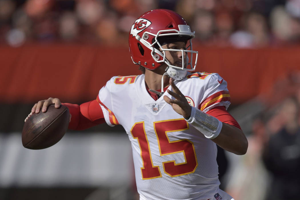 Kansas City Chiefs quarterback Patrick Mahomes (15) looks to throw during the first half of an NFL football game against the Cleveland Browns, Sunday, Nov. 4, 2018, in Cleveland. (AP Photo/David R ...