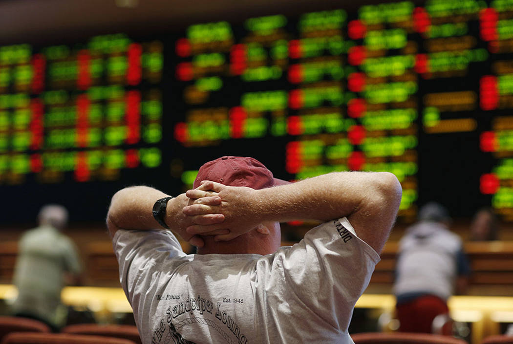 A man watches a game in the sports book at the South Point in 2018 in Las Vegas. (AP Photo/John Locher)