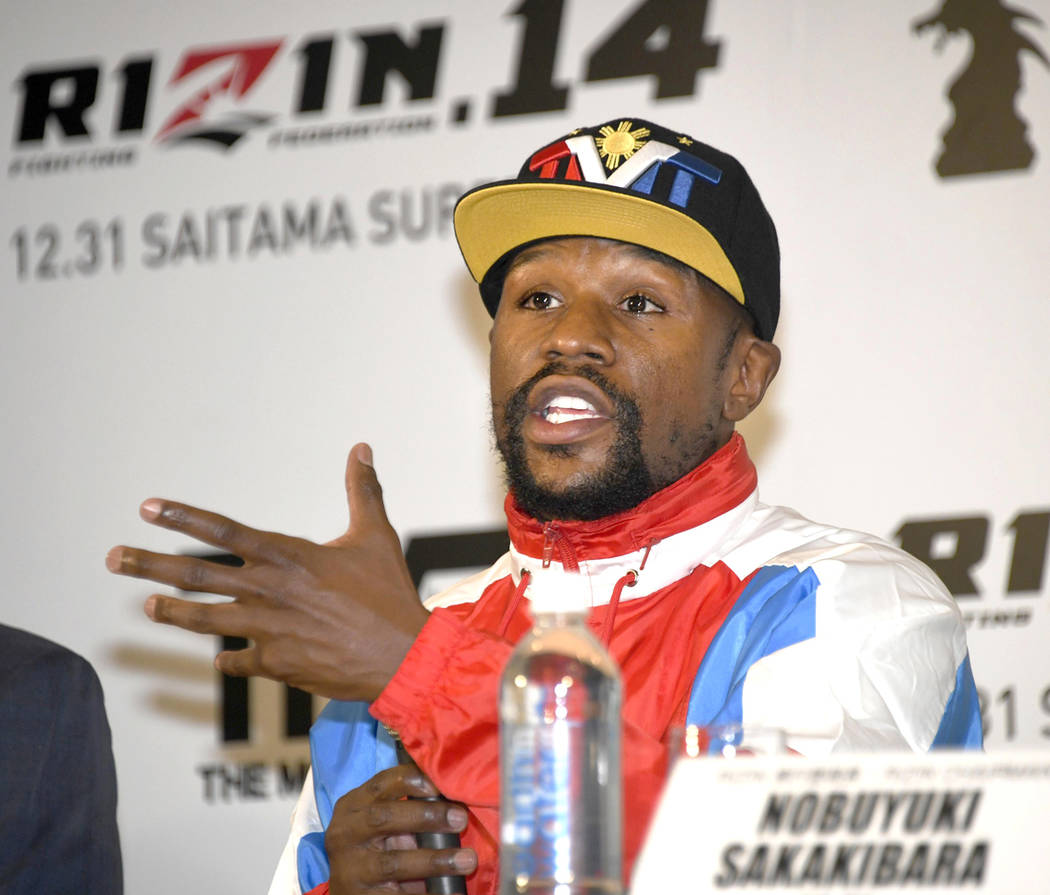 Floyd Mayweather of the U.S. speaks during a press conference in Tokyo, Monday, Nov. 5, 2018. (Katsuya Miyagawa/Kyodo News via AP)