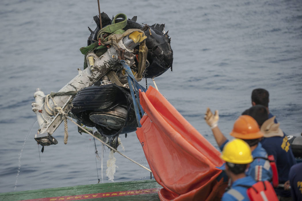 Rescuers use crane to retrieve part of the landing gears of the crashed Lion Air jet from the sea floor in the waters of Tanjung Karawang, Indonesia, Sunday, Nov. 4, 2018. Investigators succeeded ...