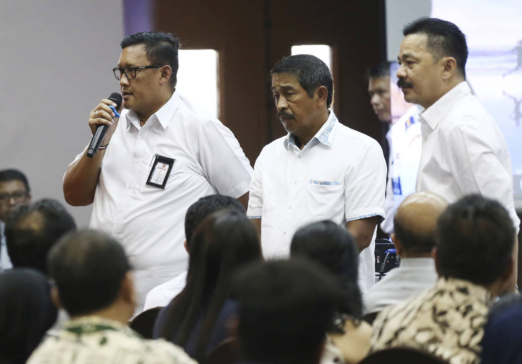 Director of Safety and Security of Lion Air, Daniel Putut Kuncoro Adi, left, talks to relatives of the victims of the crashed Lion Air jet as President Director Edward Sirait, center, and founder ...