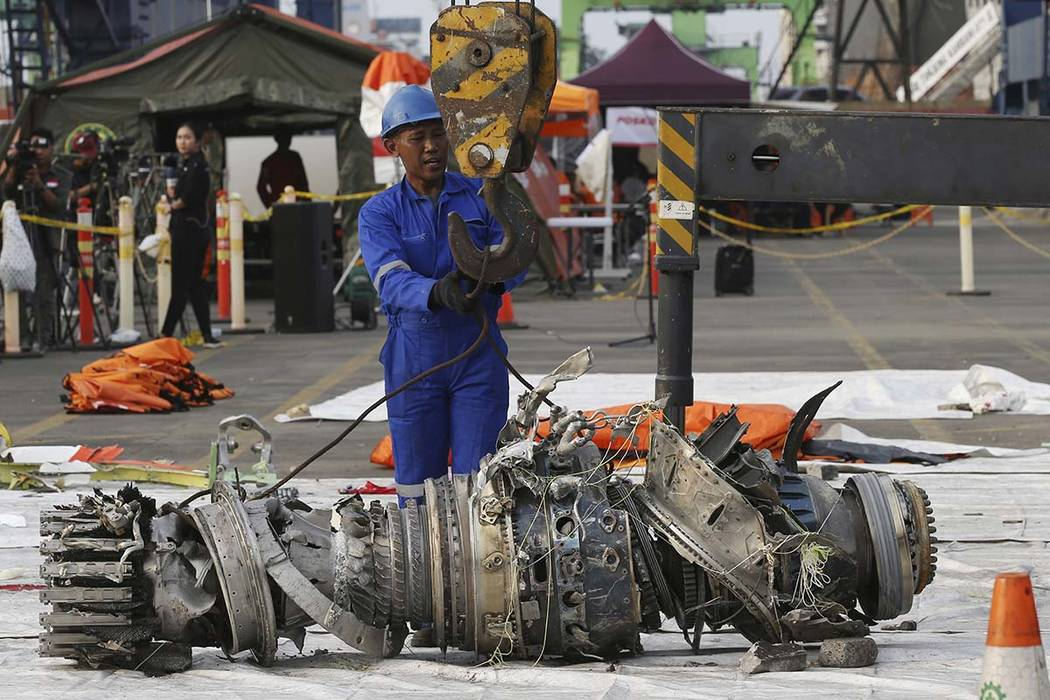 Officials move an engine recovered from the crashed Lion Air jet for further investigation in Jakarta, Indonesia, Sunday, Nov. 4, 2018. The brand new Boeing 737 MAX 8 jet plunged into the Java Sea ...