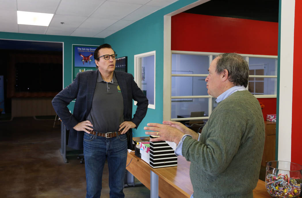 State Treasurer Dan Schwartz, right, speaks to Frank Rieger, founder and CEO of Sol-Up USA, a solar power company on Monday, March 12, 2018. Bizuayehu Tesfaye/Las Vegas Review-Journal @bizutesfaye