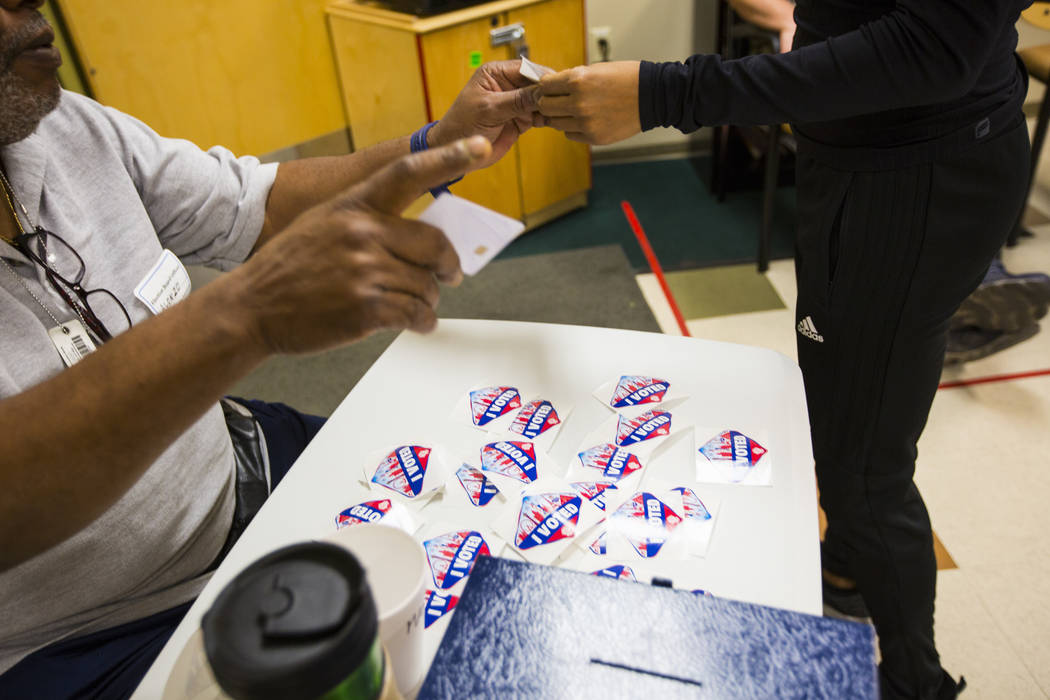 """Alonzo Gilbert hands out """"I Voted"""" stickers at a polling station at Doolittle Community Center in Las Vegas on Tuesday, Nov. 6, 2018. Chase Stevens Las Vegas Review-Journal @csstevensphoto"""