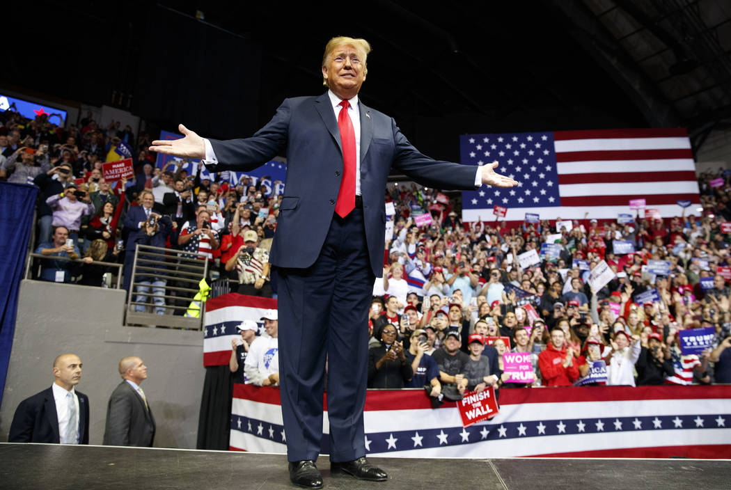 President Donald Trump arrives for a rally at Allen County War Memorial Coliseum, Monday, Nov. 5, 2018, in Fort Wayne, Ind. (AP Photo/Carolyn Kaster)