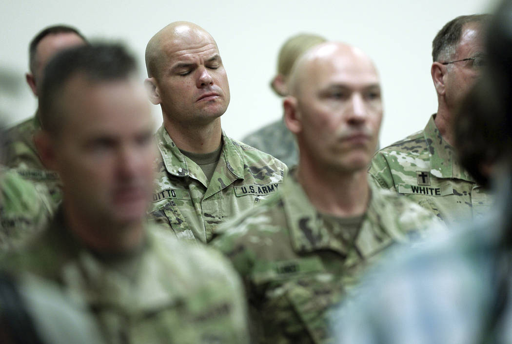 Soldiers attend a news conference where Gov. Gary R. Herbert and Maj. Gen. Jefferson S. Burton address the media Sunday, Nov. 4, 2018, in Draper, Utah, about the death of Brent Taylor, a major in ...