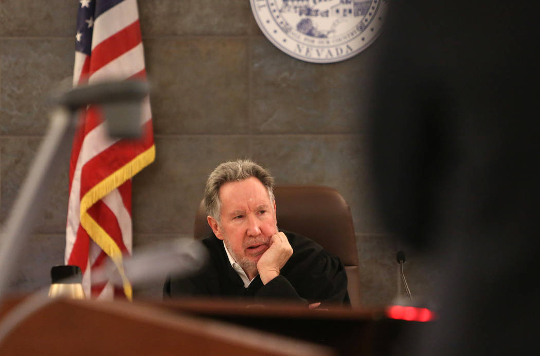 District Judge Ronald Israel presides over a case involving Nevada Assembly candidate Michael McDonald, accused of burglary and forgery charges, at the Regional Justice Center in Las Vegas on Mond ...