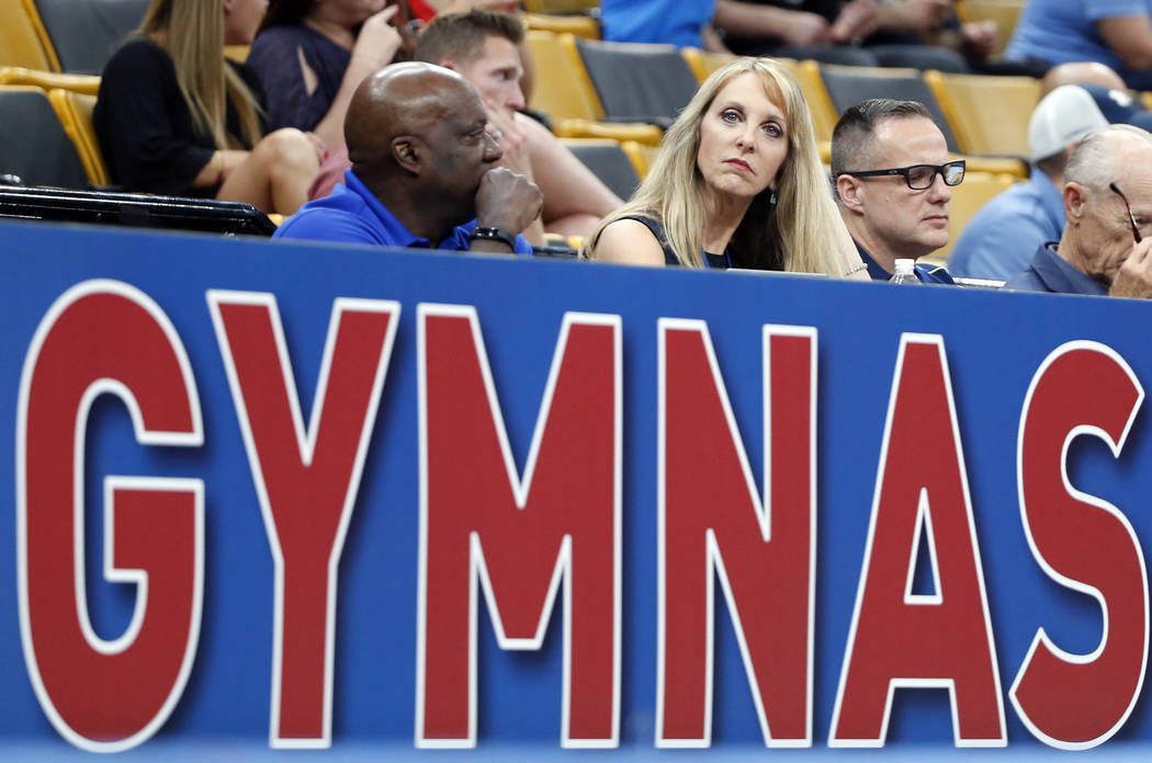 FILE - In this Aug. 16, 2018, file photo, USA Gymnastics President and CEO Kerry Perry, middle, watches the U.S. Gymnastics Championships, in Boston. Kerry Perry has resigned as president of USA G ...
