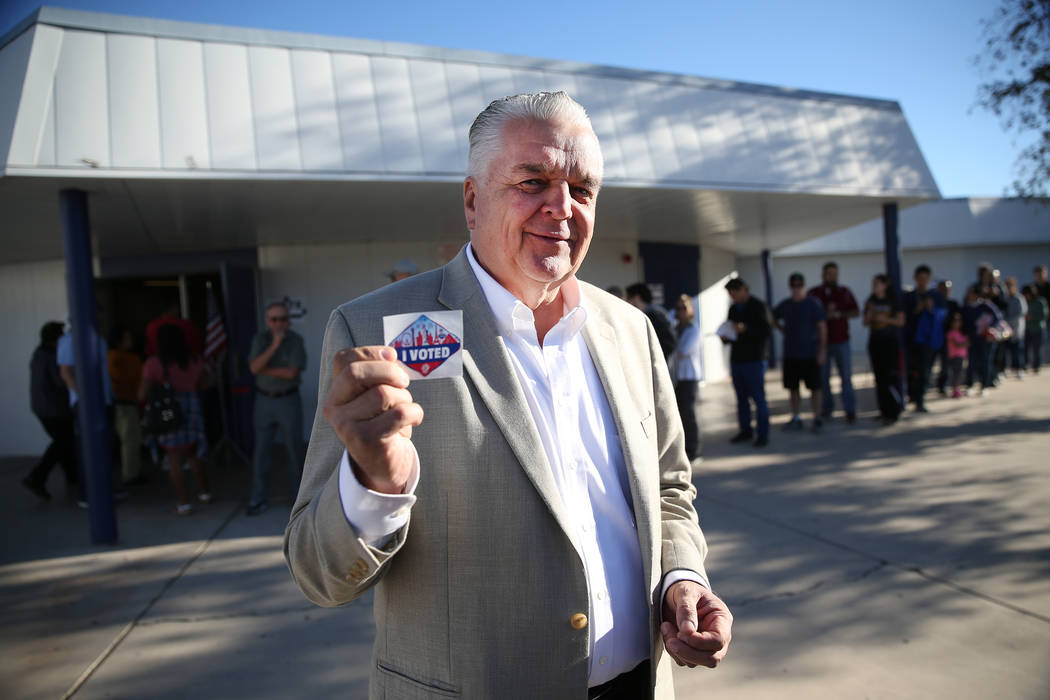 "Steve Sisolak, Democratic candidate for Nevada governor, shows his ""I Voted"" sticker at Kenny Guinn Middle School in Las Vegas, Tuesday, Nov. 6, 2018. Erik Verduzco Las Vegas Review-Jour ..."