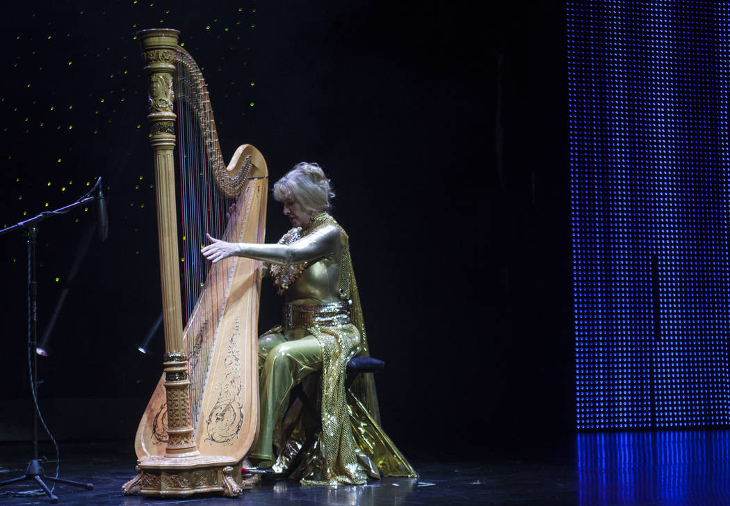Ms. Super Senior Joanie Helgesen plays the harp during the talent portion of the Miss Senior Universe Pageant at the Fabulous Saxe Theatre in Las Vegas, Saturday, Nov. 3, 2018. Rachel Aston Las Ve ...