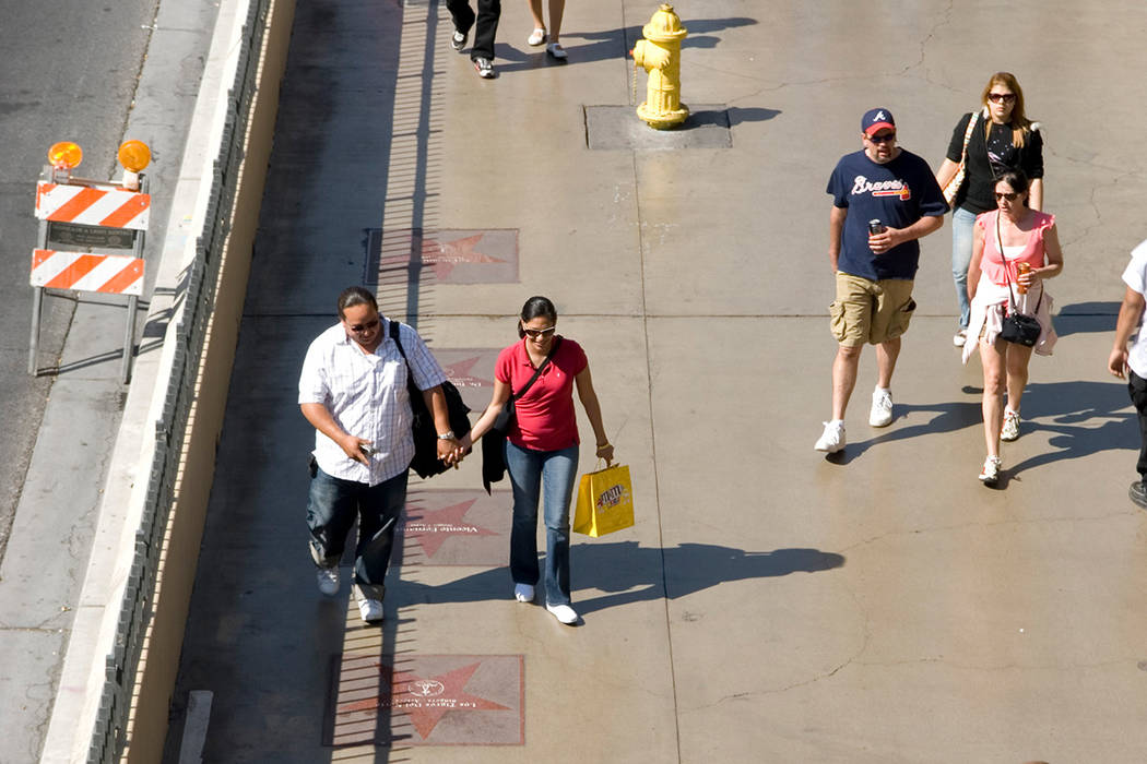 Pedestrians walk along the Las Vegas Walk of Stars in this file photo. Martin S. Fuentes/Las Vegas Review-Journal