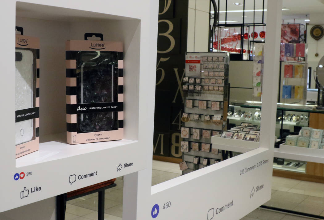 Phone cases are displayed at Facebook's new pop-up store inside of Macy's at Fashion Show on Friday, Nov. 9, 2018, in Las Vegas. Bizuayehu Tesfaye/Las Vegas Review-Journal @bizutesfaye