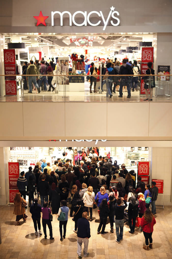 A crowd of people walks into Macy's in the Fashion Show mall in Las Vegas in this file photo. (John Locher/Las Vegas Review-Journal)
