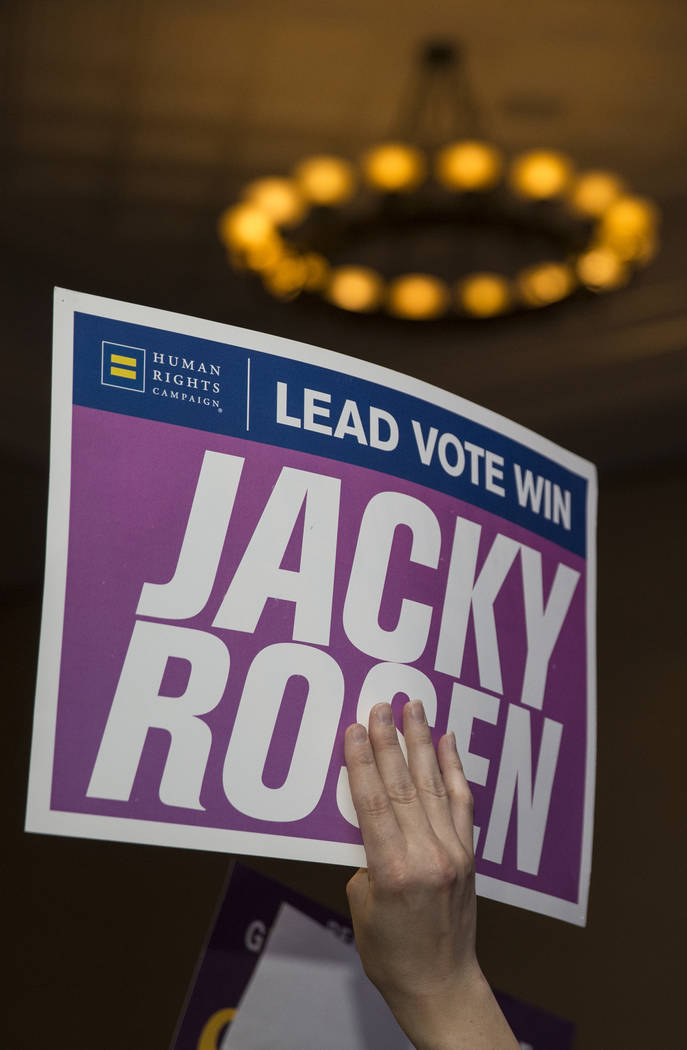 Supporters of congresswoman Jacky Rosen wave signs during an election night event hosted by the Nevada Democrats on Tuesday, November 6, 2018, at Caesars Palace, in Las Vegas. Benjamin Hager Las V ...