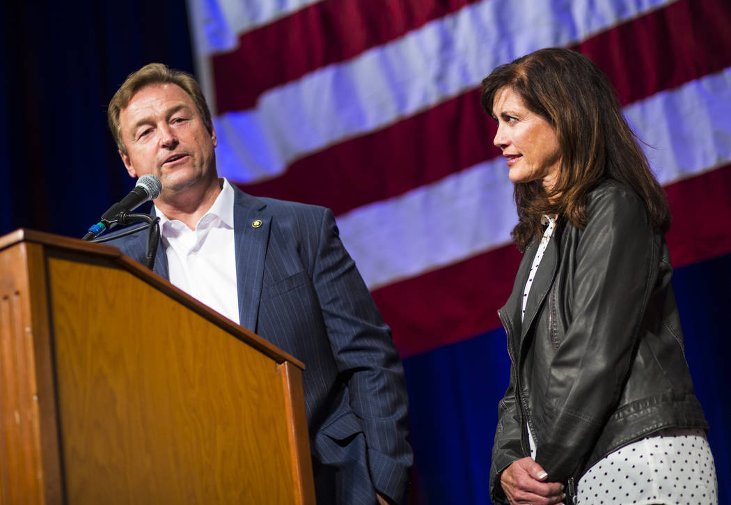 U.S. Sen. Dean Heller, R-Nev., speaks alongside his wife Lynne after conceding to challenger U.S. Rep. Jacky Rosen, D-Nev., during the Nevada Republican Party election night watch party at the Sou ...