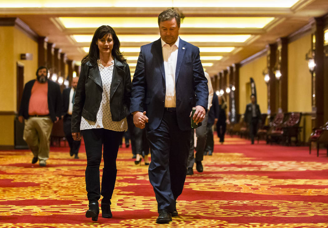 U.S. Sen. Dean Heller, R-Nev., walks with his wife Lynne after conceding to challenger U.S. Rep. Jacky Rosen, D-Nev., during the Nevada Republican Party election night watch party at the South Poi ...