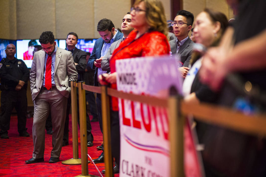 Christian Martinez looks on as Danny Tarkanian, not pictured, talks about his loss to Democratic candidate Susie Lee during the Nevada Republican Party election night watch party at the South Poin ...