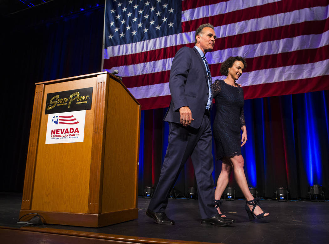 Danny Tarkanian, Republican candidate for the 3rd Congressional District, and wife Amy leave the stage after conceding to Democratic candidate Susie Lee during the Nevada Republican Party election ...
