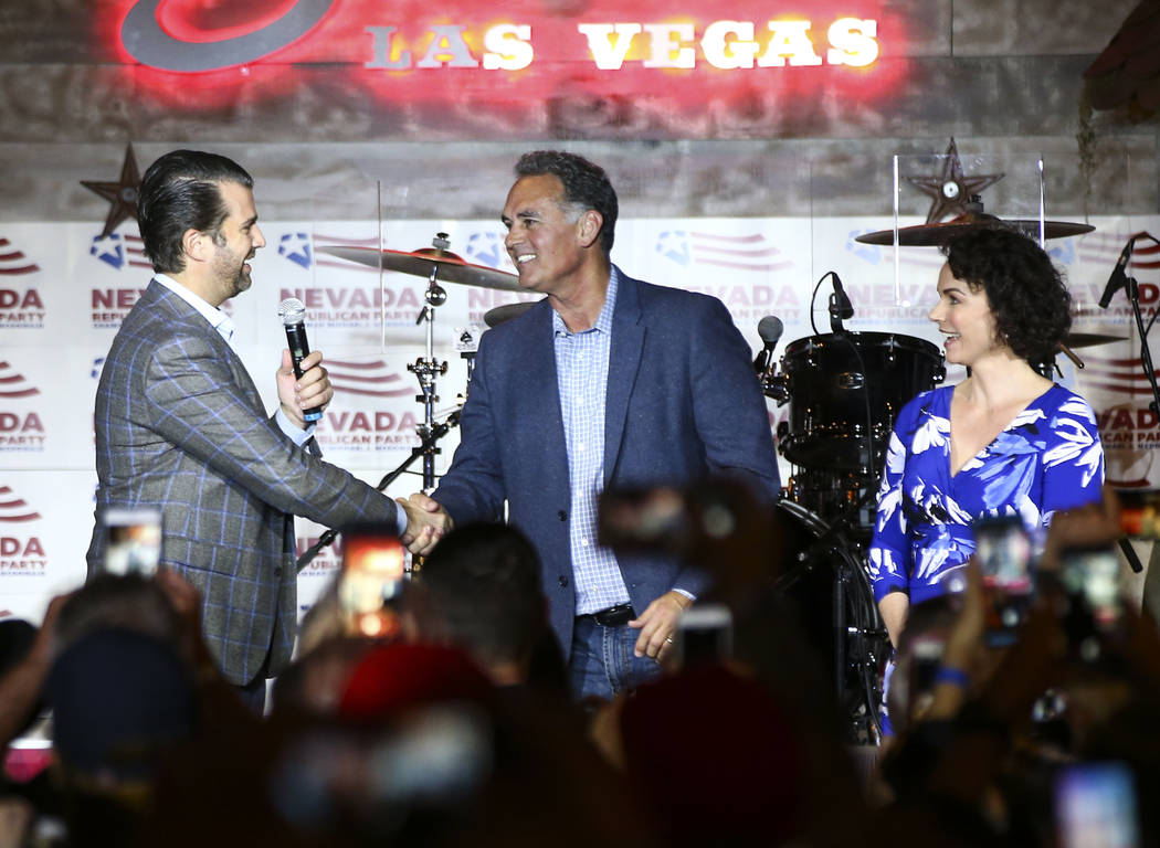 Donald Trump Jr., left, Danny Tarkanian, Republican candidate for the 3rd Congressional District, and Amy Tarkanian during a campaign event at Stoney's Rockin' Country in Las Vegas on Friday, Nov. ...