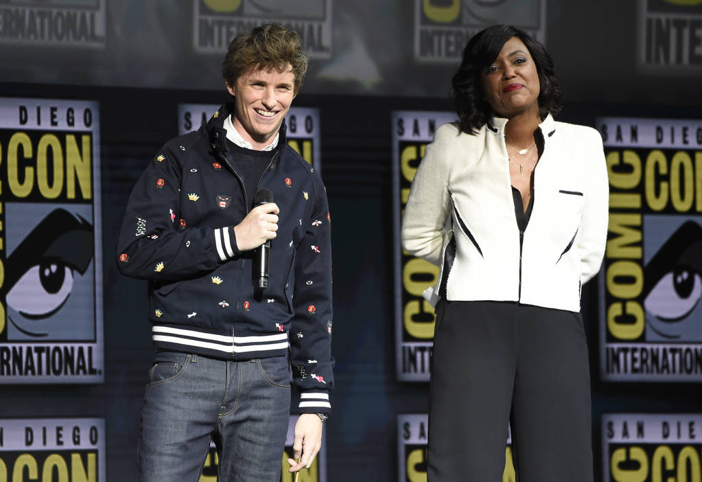 "FILE - In this July 21, 2018 file photo, Eddie Redmayne, left, and moderator Aisha Tyler attend the Warner Bros. Theatrical panel for ""Fantastic Beasts: The Crimes of Grindelwald"" on day ..."