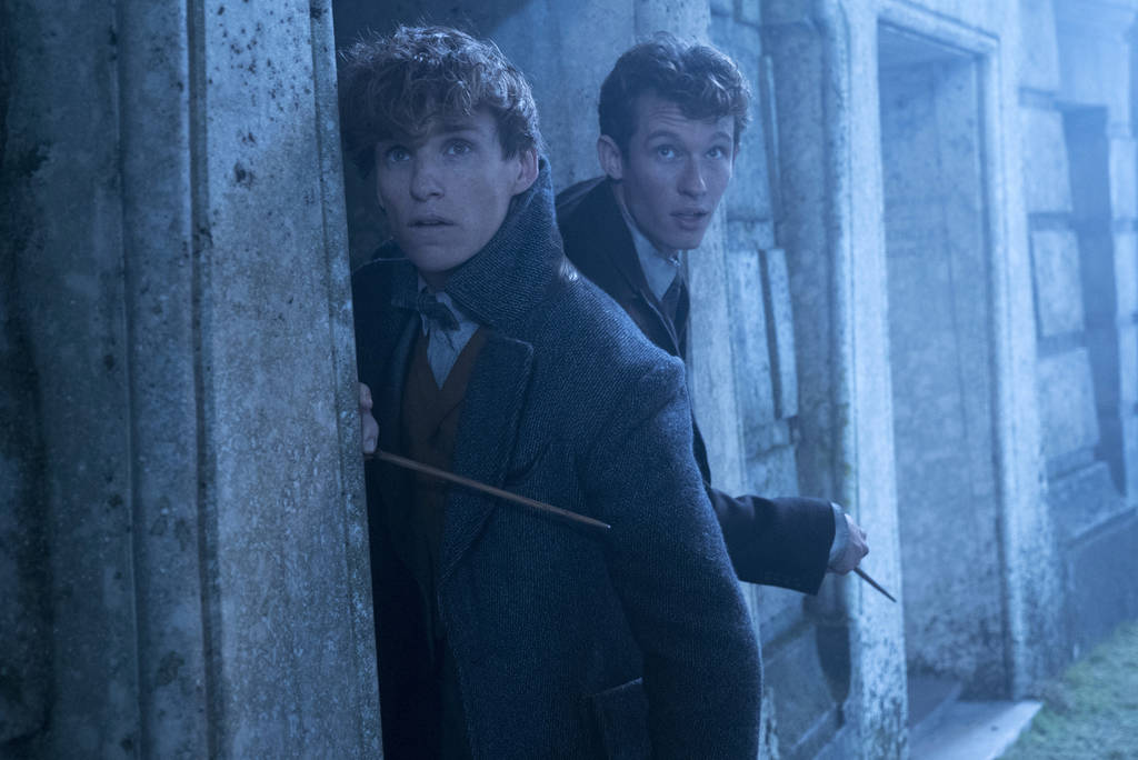 "This image released by Warner Bros. Pictures shows Eddie Redmayne, left and Callum Turner in a scene from ""Fantastic Beasts: The Crimes of Grindelwald."" (Liam Daniel/Warner Bros. Picture ..."