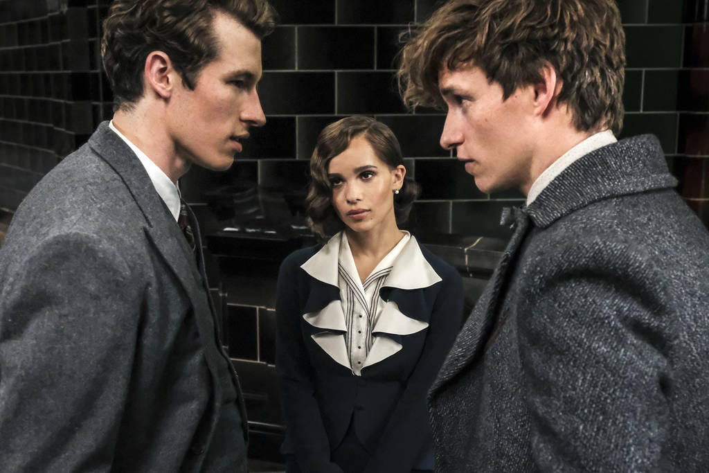 "This image released by Warner Bros. Pictures shows Callum Turner, from left, Zoe Kravitz and Eddie Redmayne in a scene from ""Fantastic Beasts: The Crimes of Grindelwald."" (Jaap Buitendij ..."