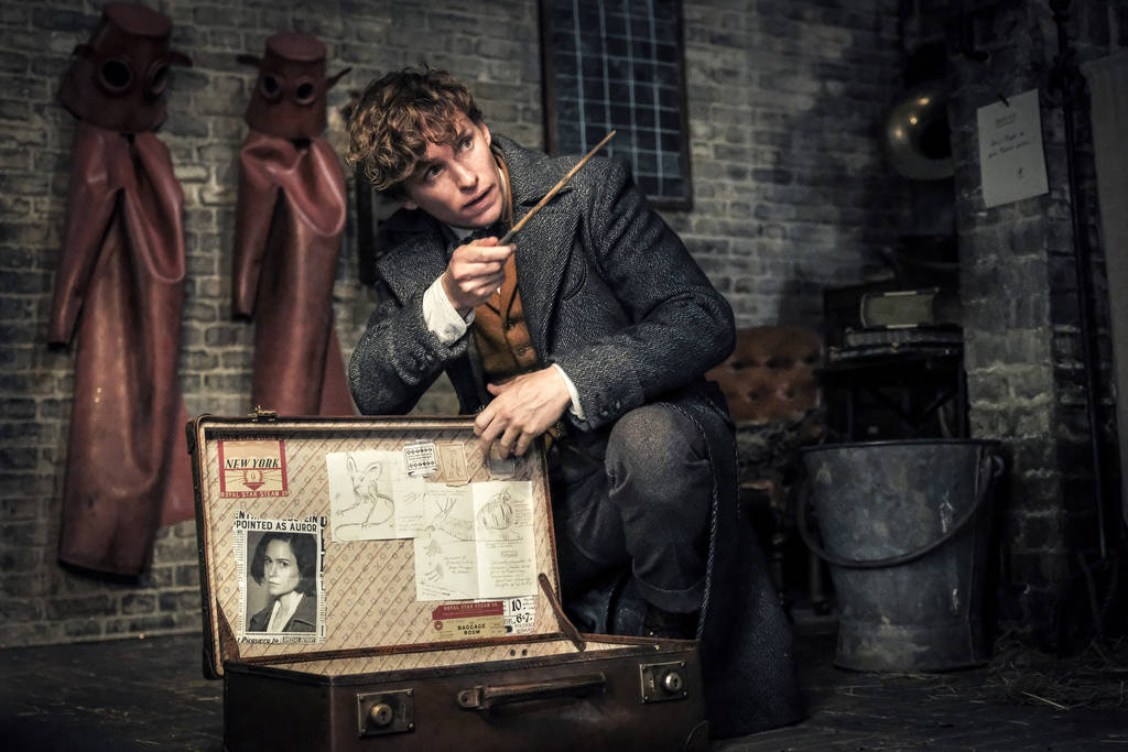 "This image released by Warner Bros. Pictures shows Eddie Redmayne in a scene from ""Fantastic Beasts: The Crimes of Grindelwald."" (Jaap Buitendijk/Warner Bros. Pictures via AP)"