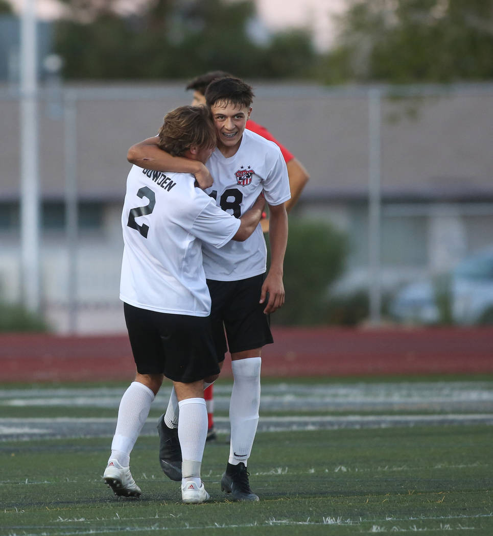 Las Vegas' Sergio Aguayo (18) celebrates with Drew Bowden (2) after scoring against Coronado during the Southern Nevada boys soccer championship at Rancho High School in Las Vegas, Monday, Nov. 5, ...