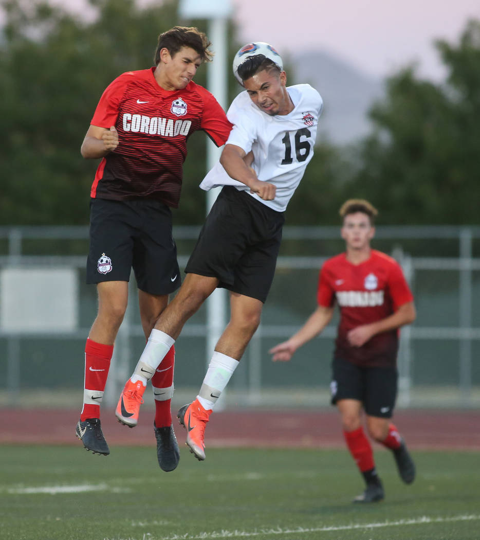 Coronado's John Baldauf (2) and Las Vegas' Nathan Zamora (16) jump up for the ball during the Southern Nevada boys soccer championship at Rancho High School in Las Vegas, Monday, Nov. 5, 2018. Car ...