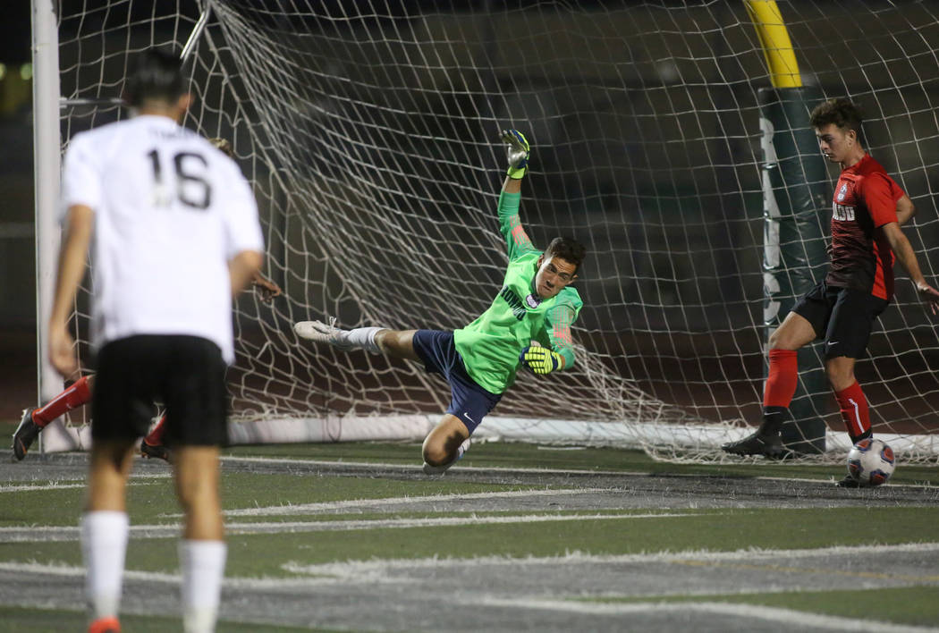 Las Vegas' Carlos Sanchez (3) scores against Coronado's Josue Ruiz during the Southern Nevada boys soccer championship at Rancho High School in Las Vegas, Monday, Nov. 5, 2018. Caroline Brehman/La ...