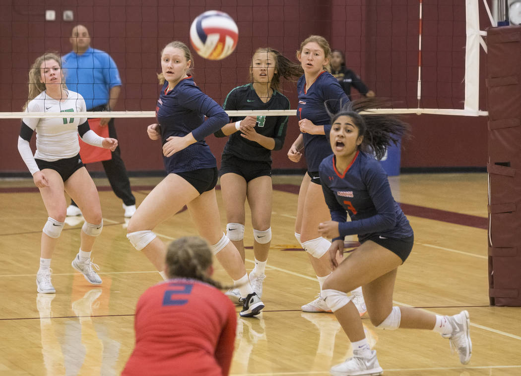 Coronado junior Dallas Balanay-Flores (3) looks for help from teammate Kennedi Steele (2) during the Cougars Class 4A state volleyball quarterfinal game with Coronado on Monday, November 5, 2018, ...