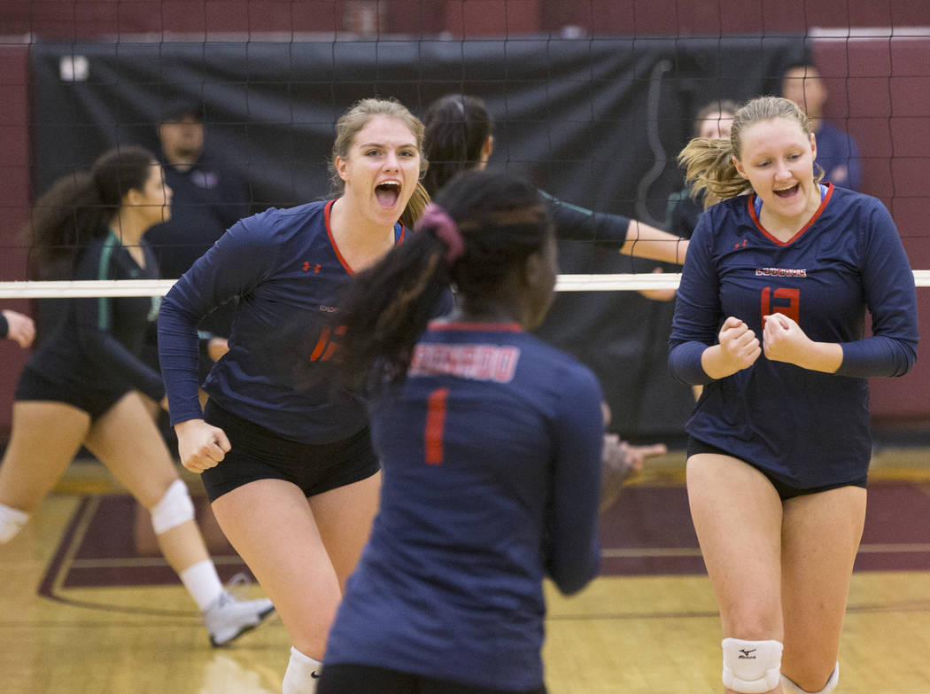Coronado junior Phoebe Mauriello-Crozer (6) celebrates with teammate Ashlynn Ammerman (13) after winning a point during the Class 4A state volleyball quarterfinal on Monday, November 5, 2018, at E ...