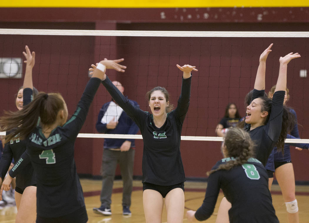Palo Verde junior Alyssa Hewitt (12) celebrates with teammates after scoring a point against Coronado during the Class 4A state volleyball quarterfinal on Monday, November 5, 2018, at Eldorado Hig ...