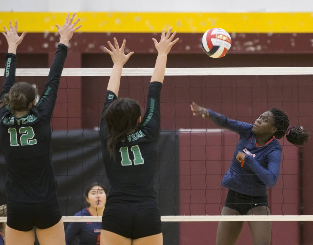 Coronado sophomore Morenike Ajayi (1) spikes the ball over Palo Verde juniors Alyssa Hewitt (12) and Arien Fafard (11) during the Class 4A state volleyball quarterfinal on Monday, November 5, 2018 ...