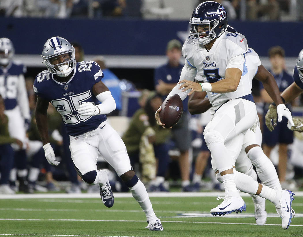 Tennessee Titans quarterback Marcus Mariota (8) runs out of the pocket against the Tennessee Titans during the first half of an NFL football game, Monday, Nov. 5, 2018, in Arlington, Texas. (AP Ph ...